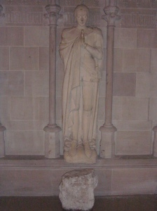 Sculpture of Joan of Arc, above a stone removed from her cell